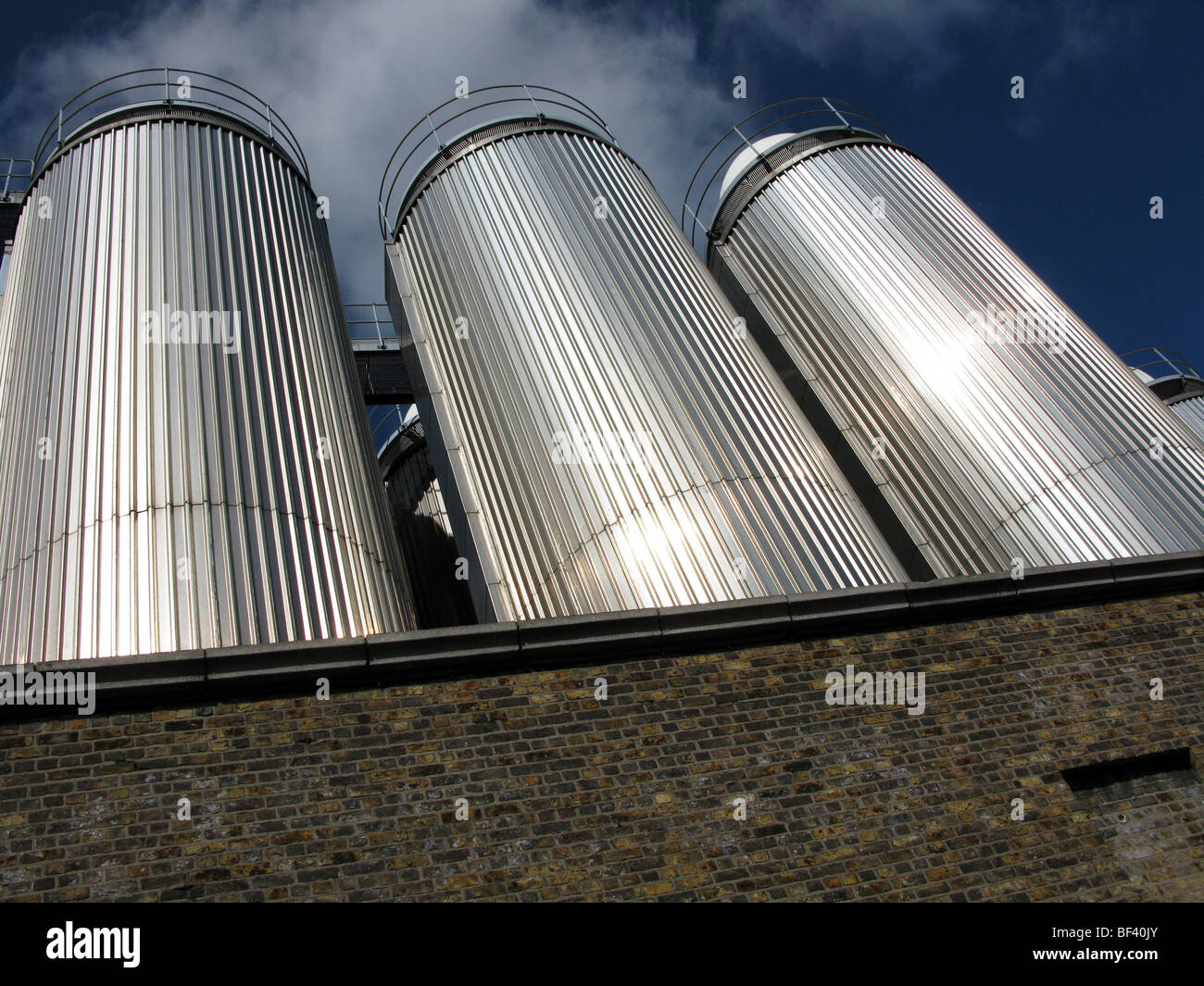 Beer tanks at a factory building near Dublin - Stock Image