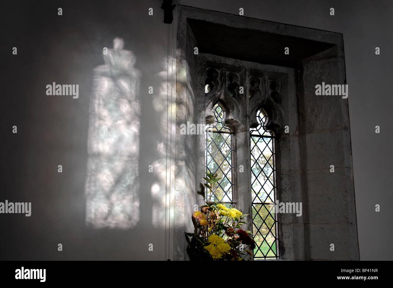 Diffuse light on wall from windows, St. Michael`s Church, Baddesley Clinton, Warwickshire, England, UK - Stock Image