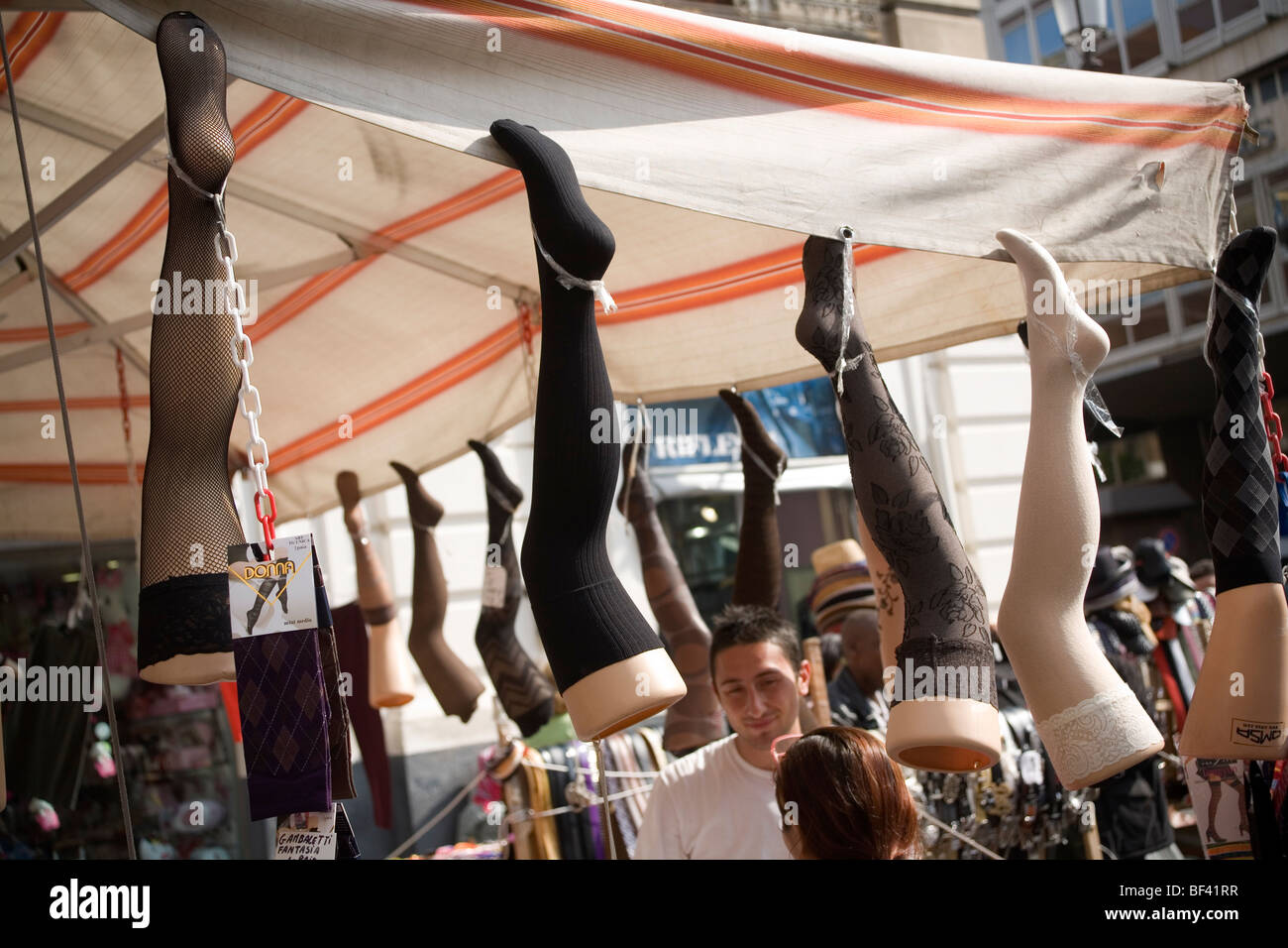 Women stockings on dummy legs for sale in the market - Stock Image