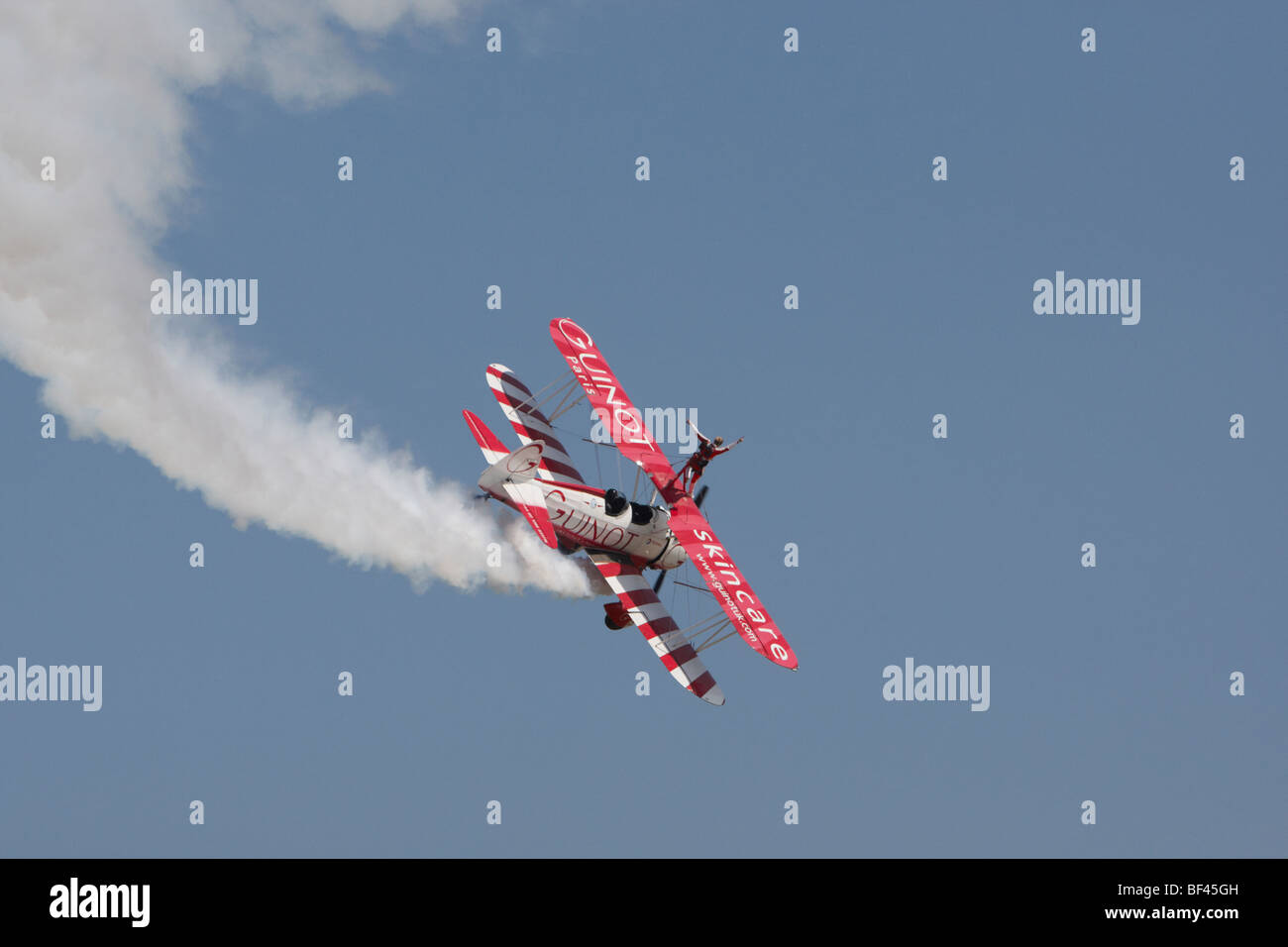 Guinot wingwalker on biplane at Clacton, Essex, England, United Kingdom - Stock Image