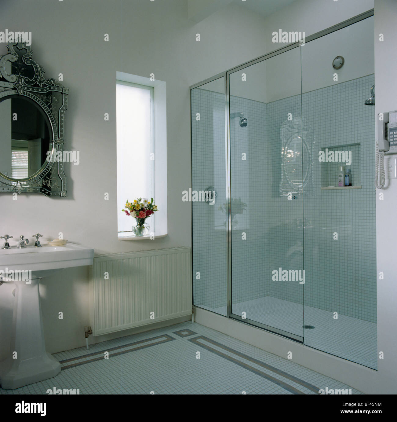 Glass wall and door to walk-in shower cabinet in modern white Stock ...