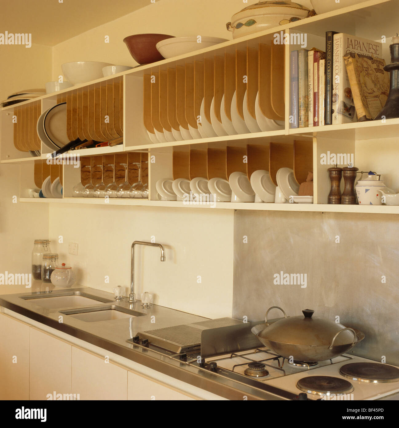 Cream shelving with large fitted plate rack above sink and hob in modern kitchen & Cream shelving with large fitted plate rack above sink and hob in ...