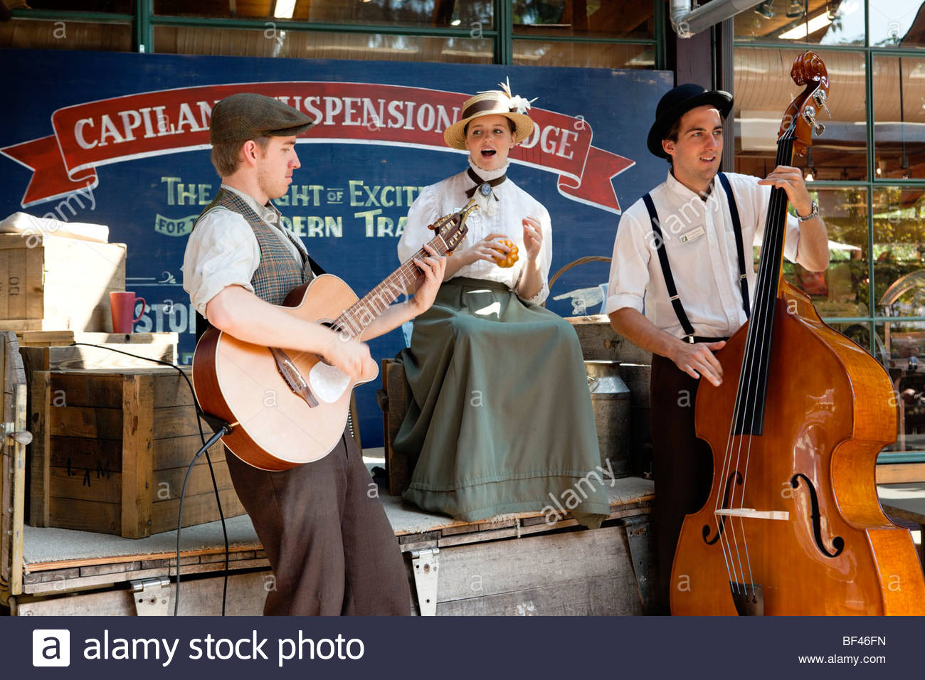 Old-Time Musicians Singing a Song at Capilano Suspension Bridge, North Vancouver, B.C. - Stock Image