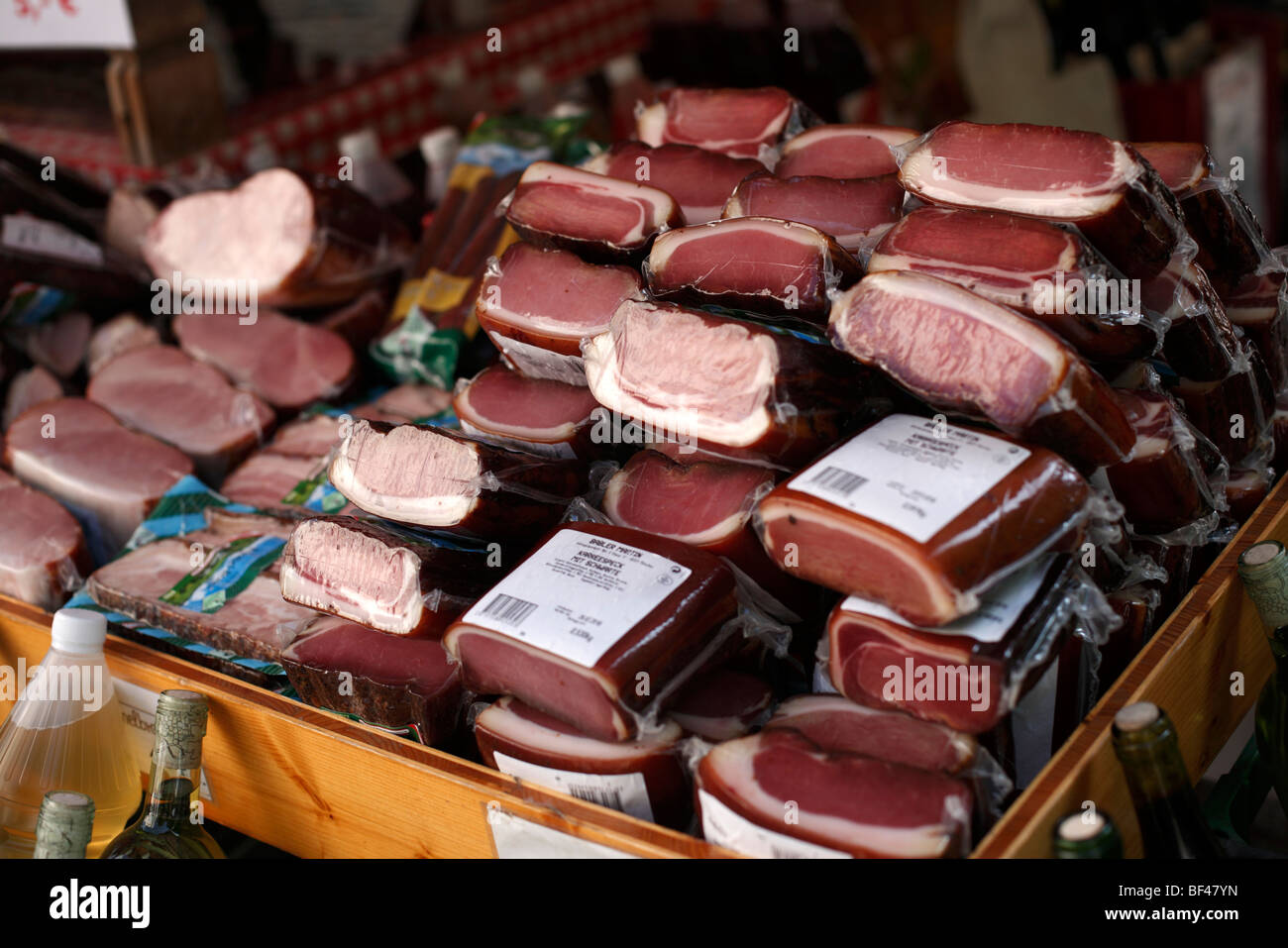 Cured meat on sale on a market stall in Germany - Stock Image