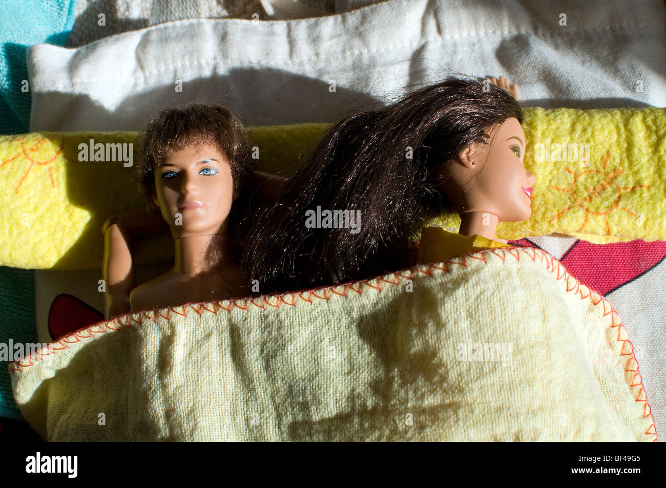sexualization of children in the media,Relationship Issues acted by dolls - Stock Image