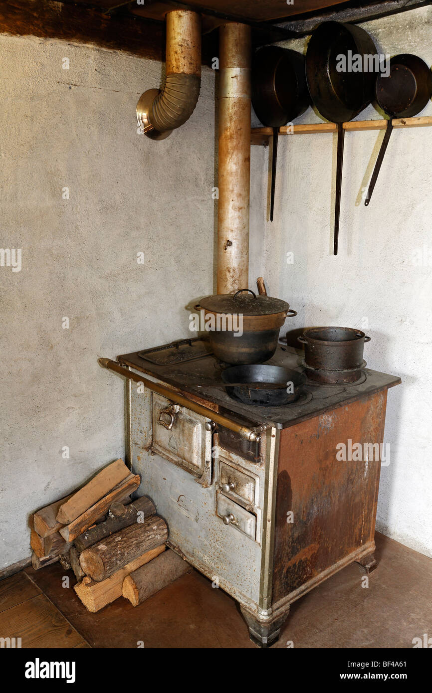 Old stove with an oven pipe, kitchen, historic bakery from 1730, Wolfegg Farmhouse Museum, Allgaeu, Upper Swabia, - Stock Image