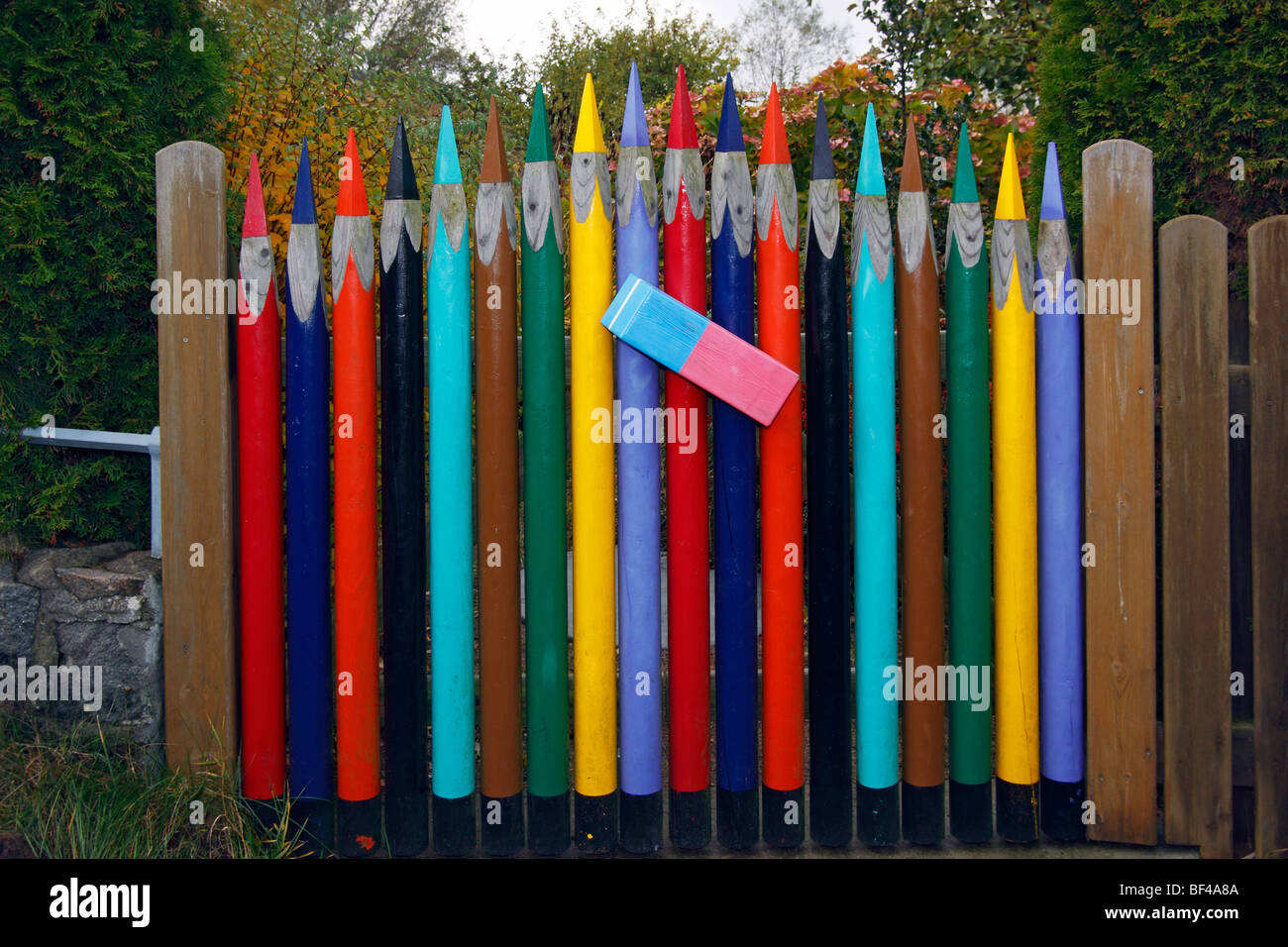 Inventive wooden fence with gate from crayons and a eraser, Gothmund, Hanseatic City of Luebeck, Germany, Europe - Stock Image