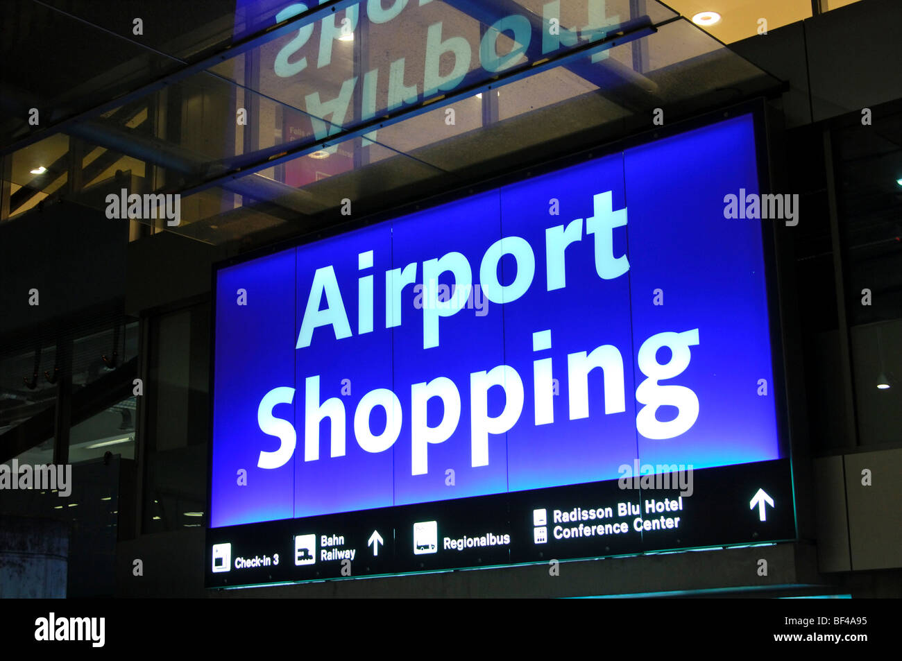 Neon sign at the entrance to the Airport Shopping Arcade at the Airport Zurich-Kloten, Zurich, Switzerland, Europe - Stock Image