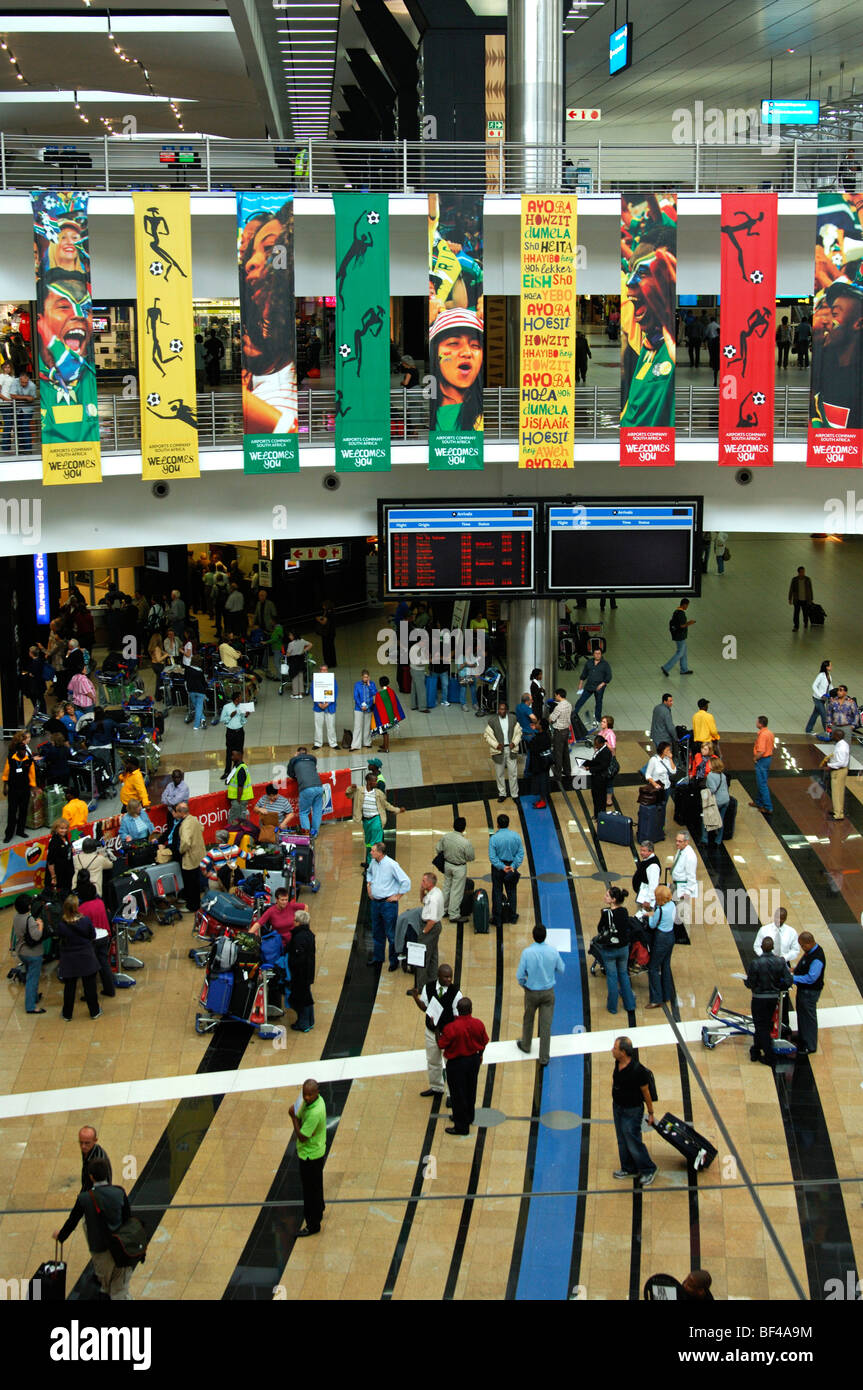 Travelers in the arrival hall at the O.R. Tambo International Airport, ORTIA, Johannesburg, South Africa, Africa - Stock Image