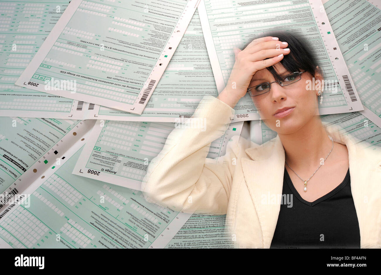 Symbolic image for red tape nightmare, income tax return - Stock Image