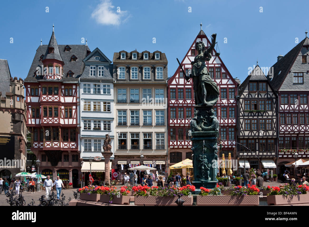 Statue of Justice holding a scale in her hand on the Roemer, City Hall Square, Frankfurt am Main, Hesse, Germany, - Stock Image