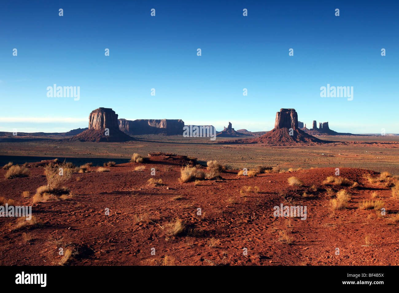 Many Buttes of Monumement Valley on a Clear Blue Sky Day - Stock Image