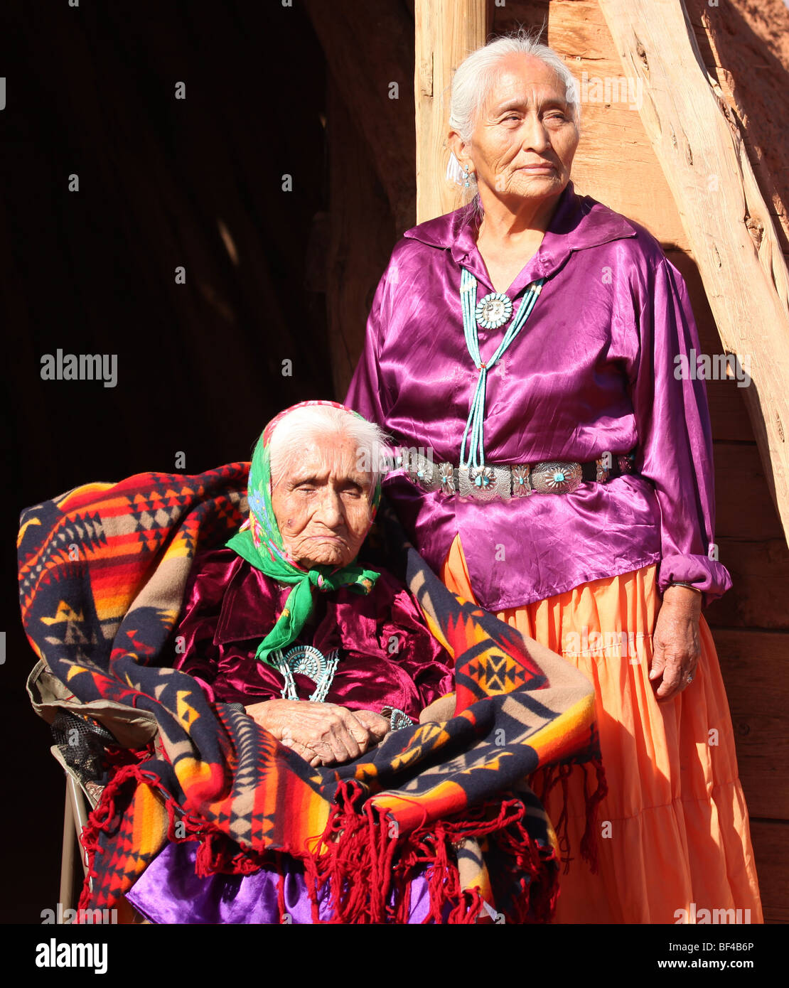 Two Navajo Wise Elderly Women Outdoors in Bright Sun - Stock Image