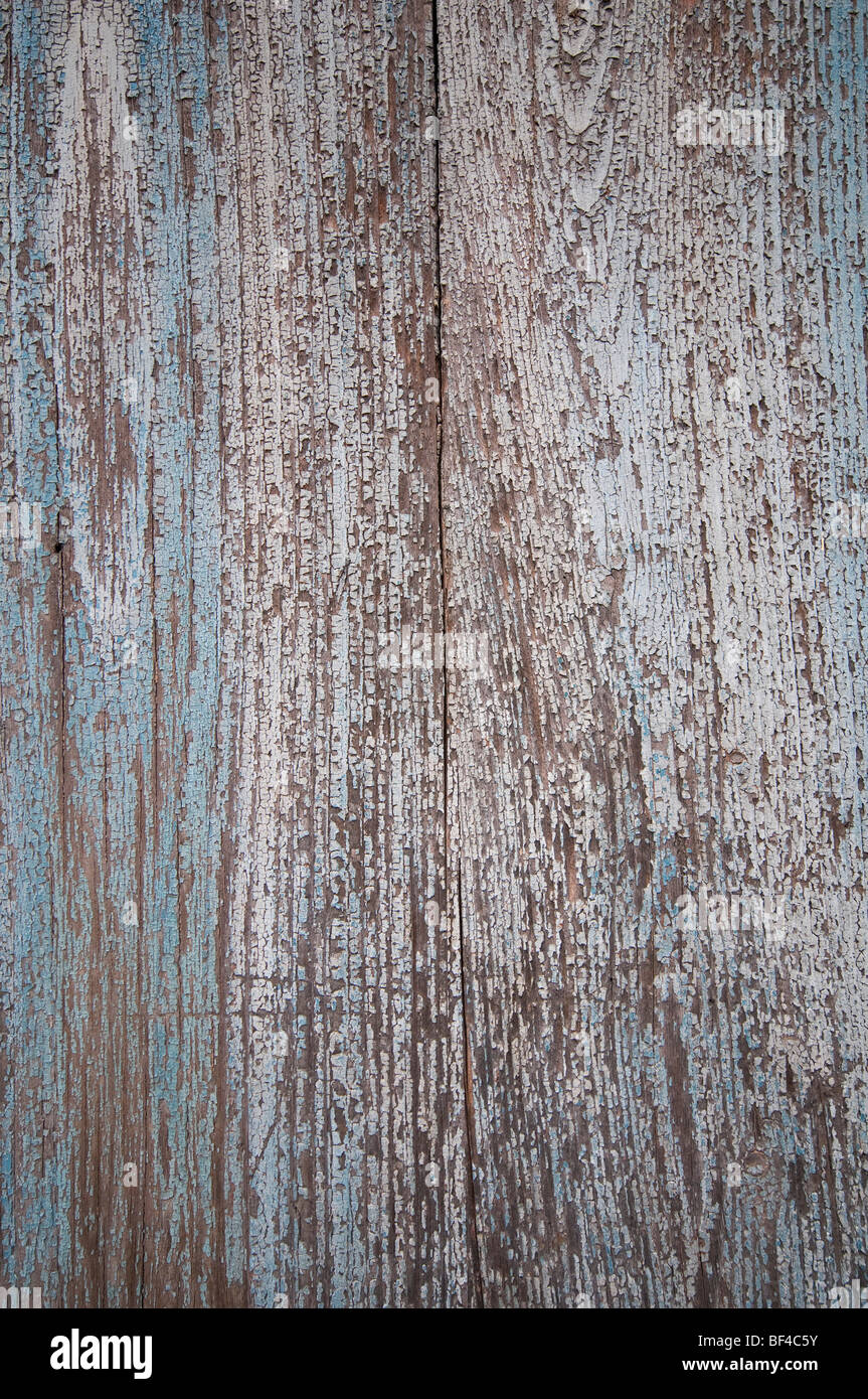 Wooden surface with weathered paint, background - Stock Image