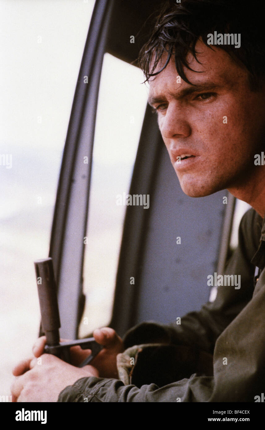 An infantryman looks out from a Huey helicopter while serving in B Troop, 1/9th Cavalry during the Vietnam War. - Stock Image