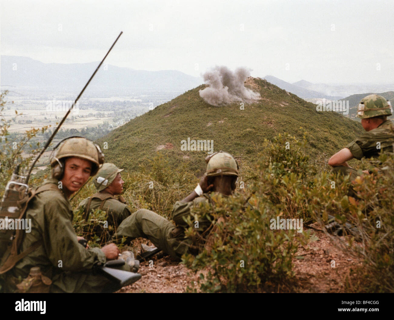 The Blues light infantry watches as a strike hit its target. B Troop, 1st Squadron, 9th Cavalry during the Vietnam - Stock Image