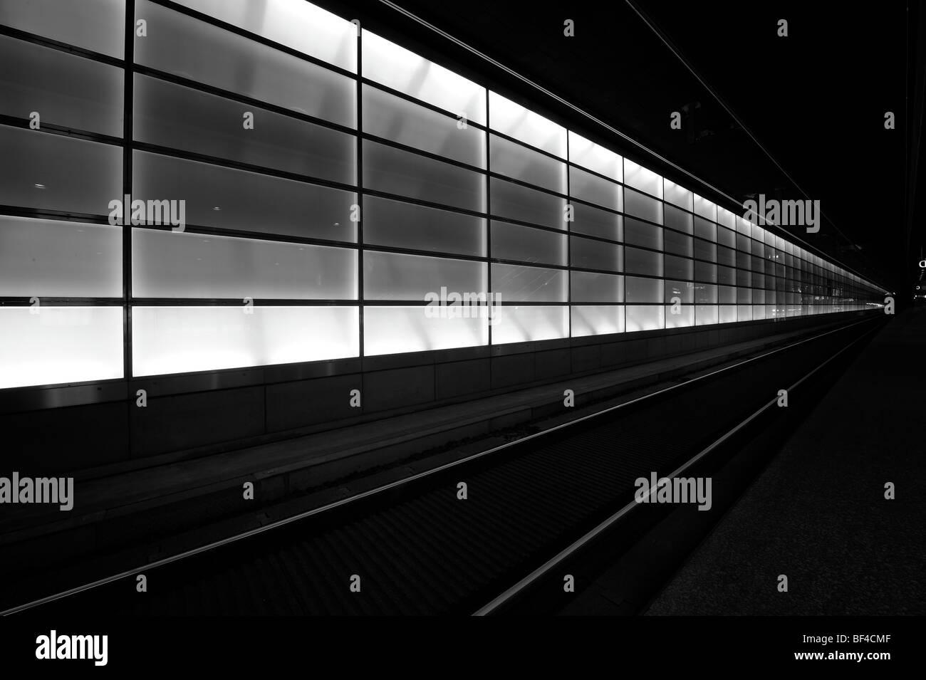 Train tracks at a railway station, Berlin Germany - Stock Image