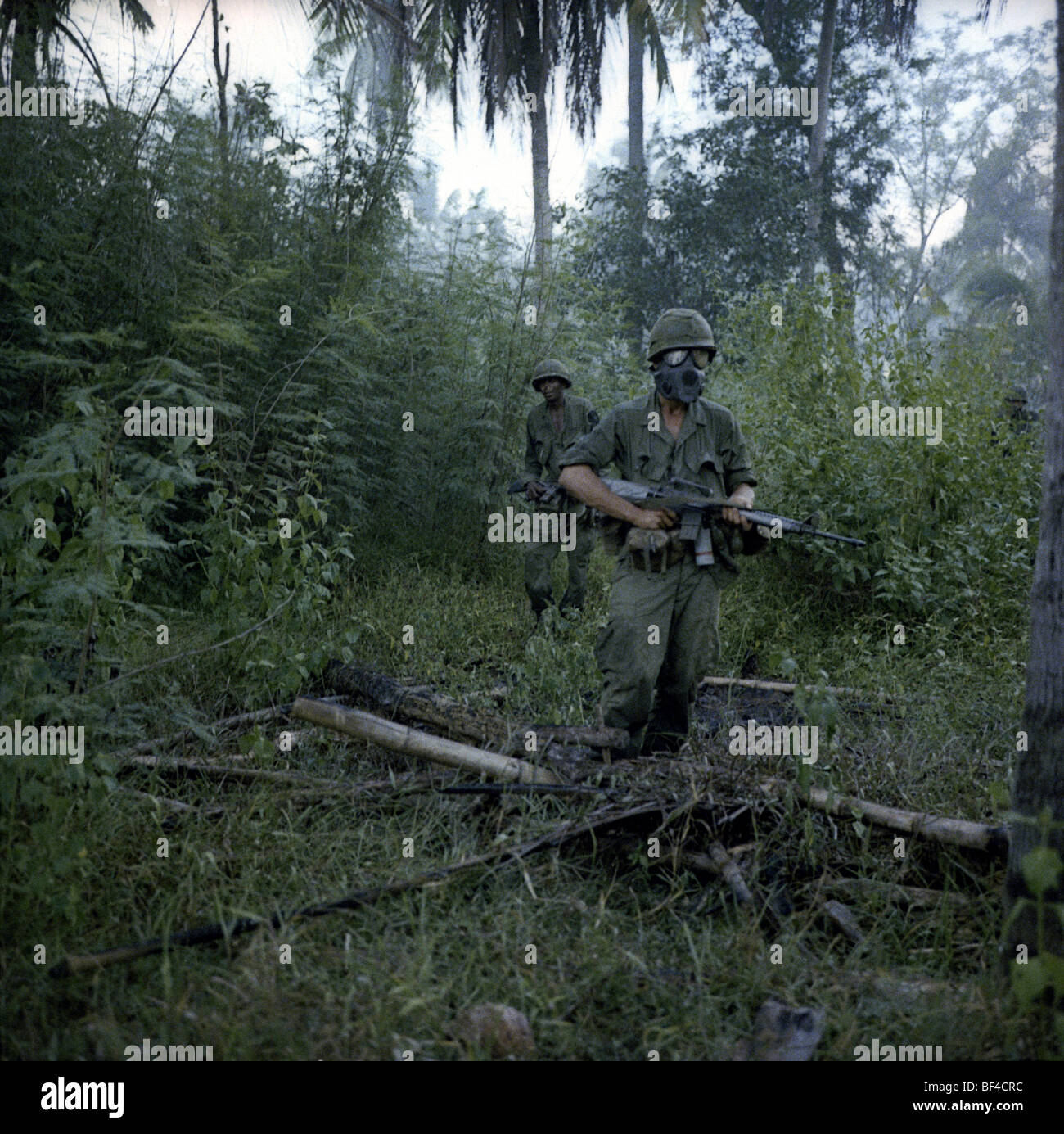 Infantry of B Troop, 1st Squadron, 9th Cavalry on patrol during during the Vietnam War in 1967. - Stock Image