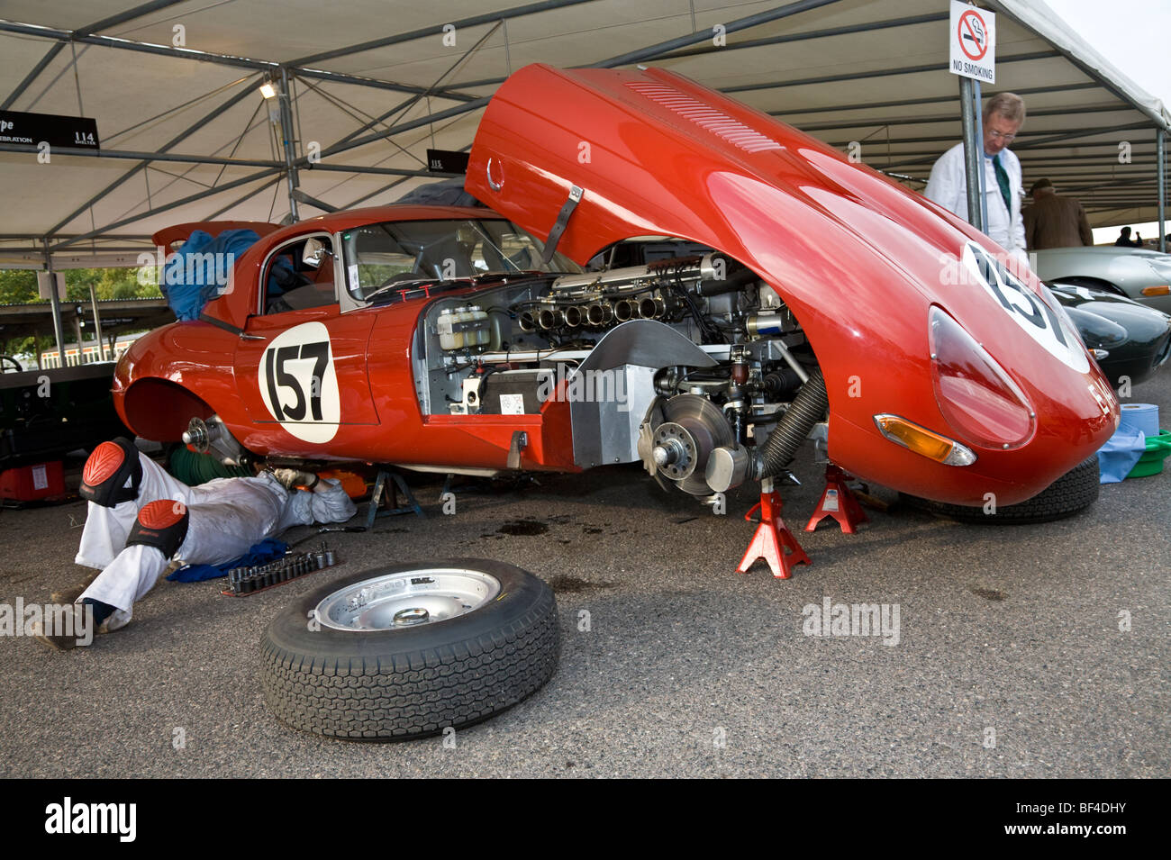 1961 Jaguar E-Type being worked on in the paddock by mechanic. RAC TT entrant at the 2009 Goodwood Revival, Sussex, - Stock Image