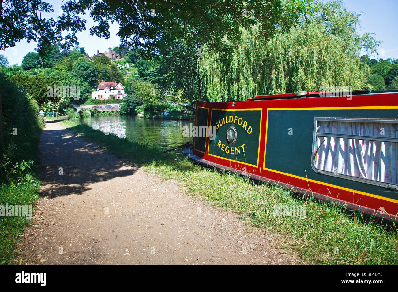 A green canal Narrowboat on the Wey & Arun Canal in Surrey, England UK 2009 - Stock Image