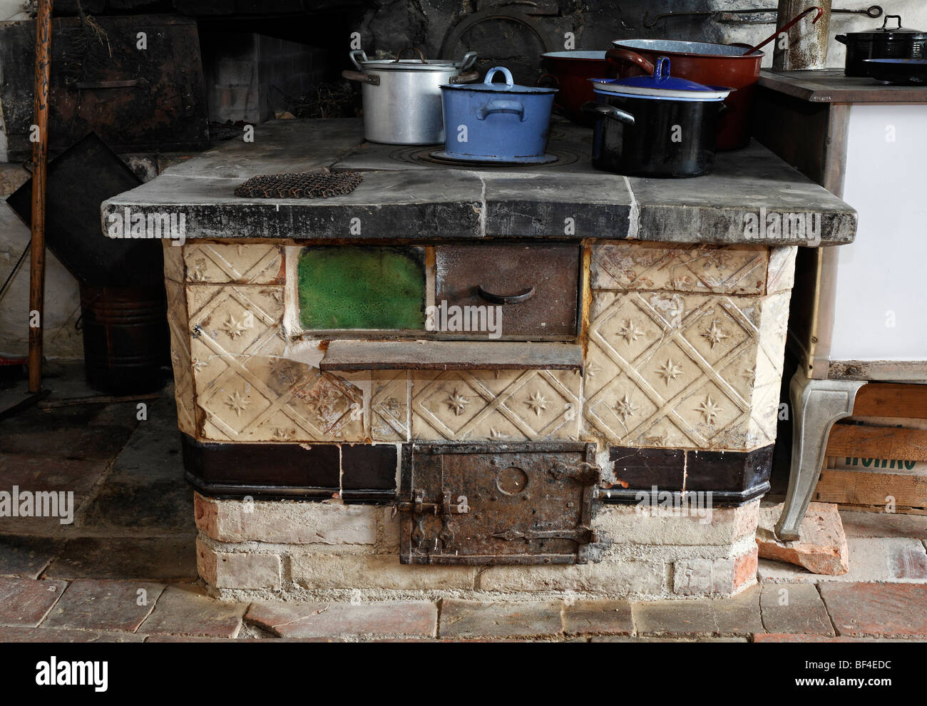Old wood stove, kitchen in the Haus Andrinet house from 1740, Wolfegg farmhouse museum, Allgaeu region, Upper Swabia, - Stock Image