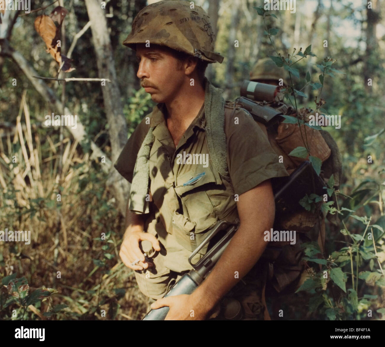 A member of the 1st Cavalry division walks on patrol during 1968 in the Vietnam War. - Stock Image
