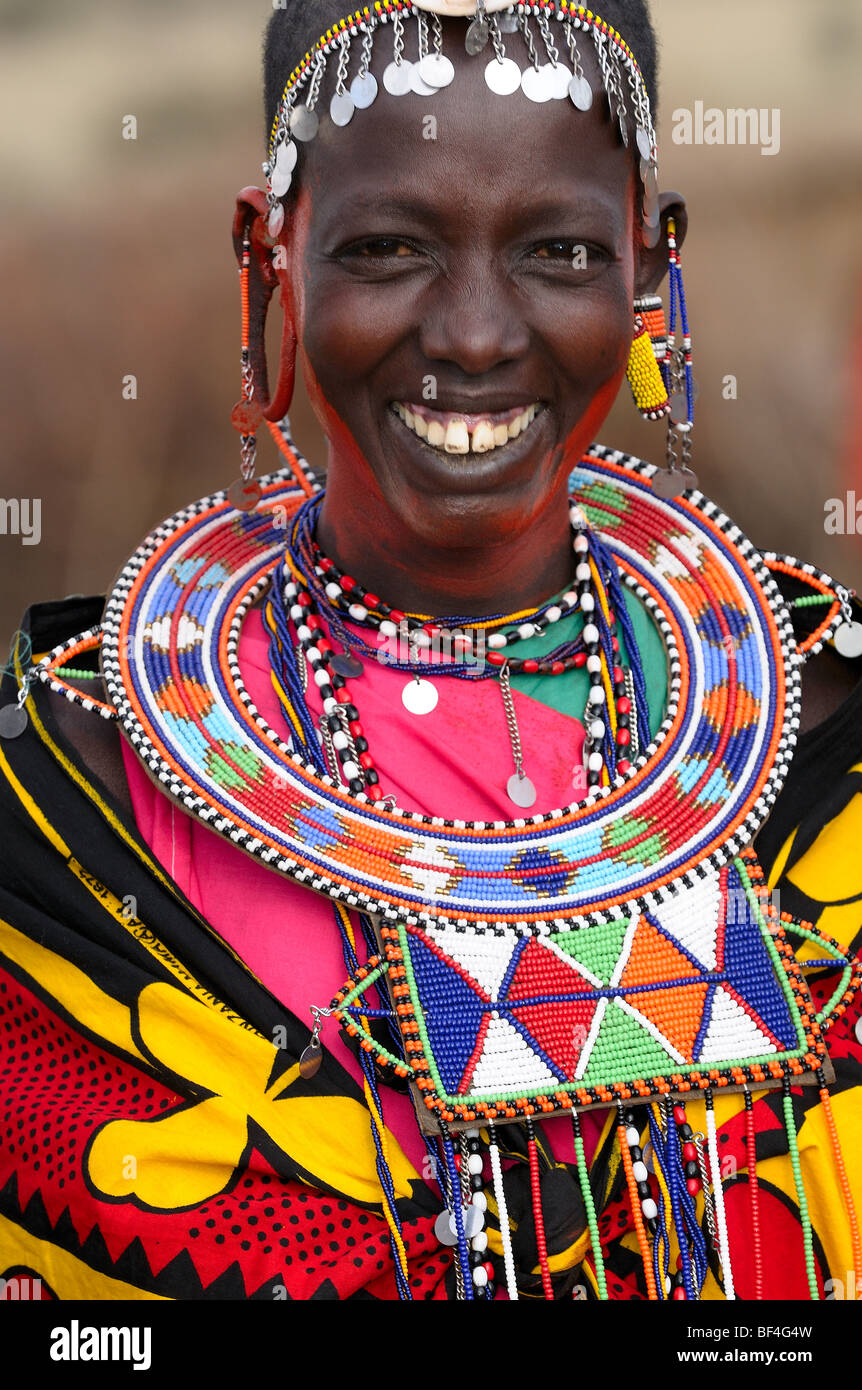 Maasai women dressed in traditional costumes in their village. - Stock Image 8ece2d8ebc