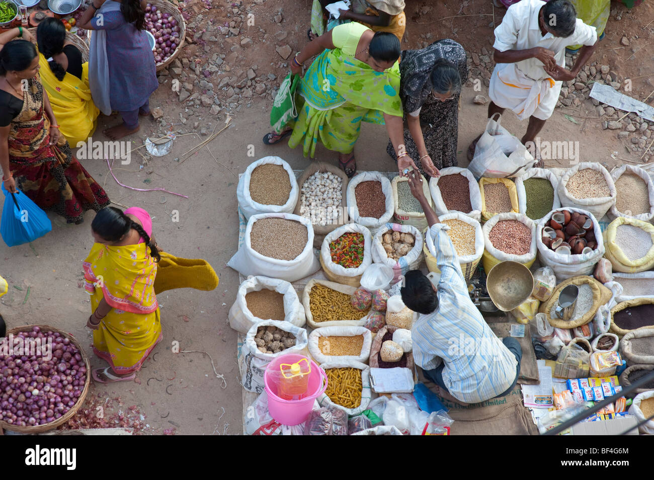 Indian street market with sacks of Indian spices and dried produce. Puttaparthi, Andhra Pradesh, India - Stock Image