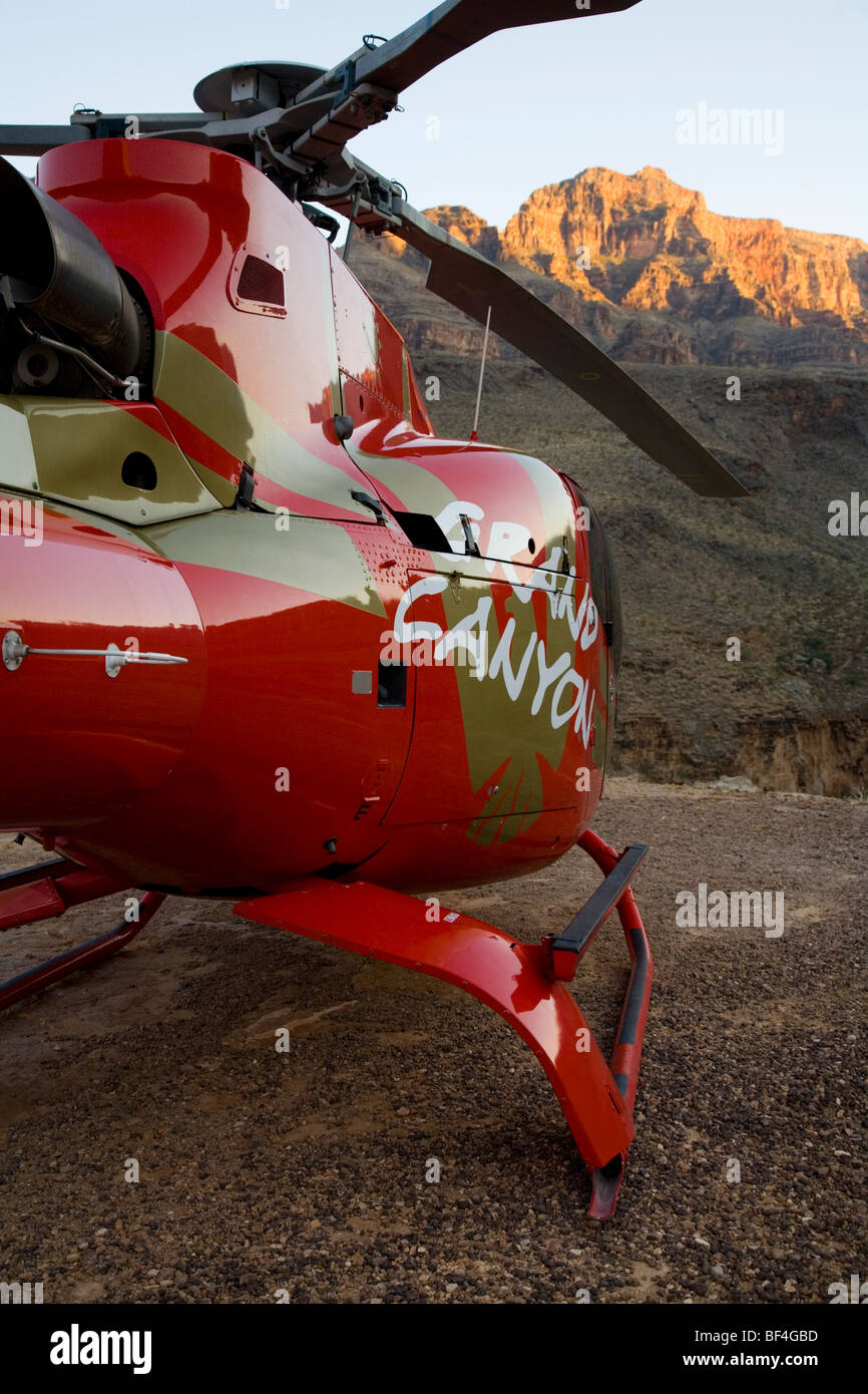 Helicopter parked in Grand Canyon at sunset - Stock Image