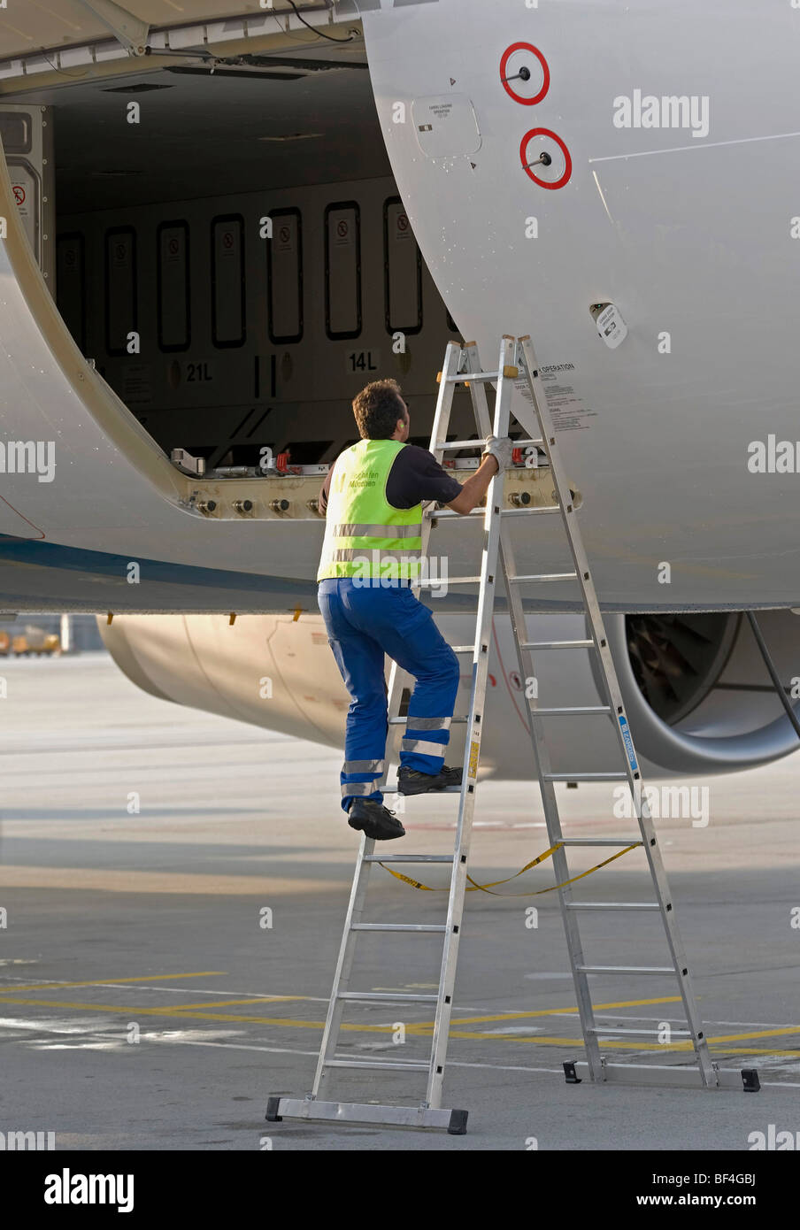Ground Crew Working On A Cargo Door Of An Airbus A330 200