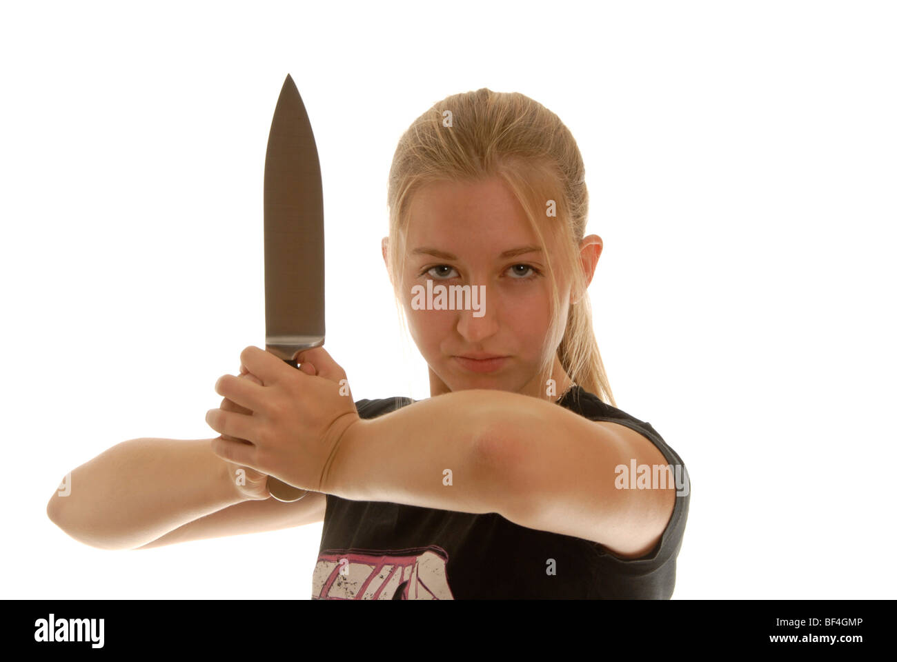 Eighteen year old woman with a knife, defense - Stock Image