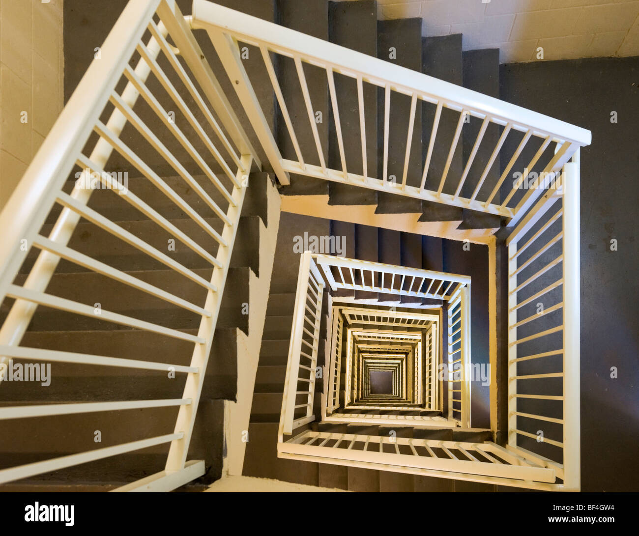 View looking down a stairwell from the top floor - Stock Image