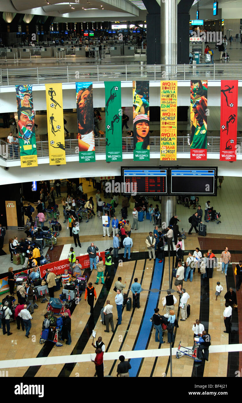 Travellers in the arrival hall of the O.R. Tambo International Airport (ORTIA), Johannesburg, South Africa - Stock Image