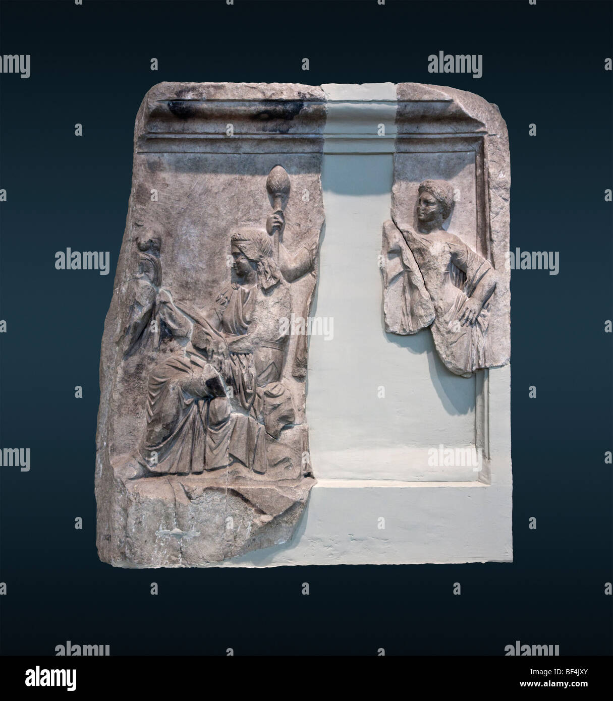 Relief in Piraeus depicting Nysa and two nymphs, one of which holds a thyrsos. Stock Photo