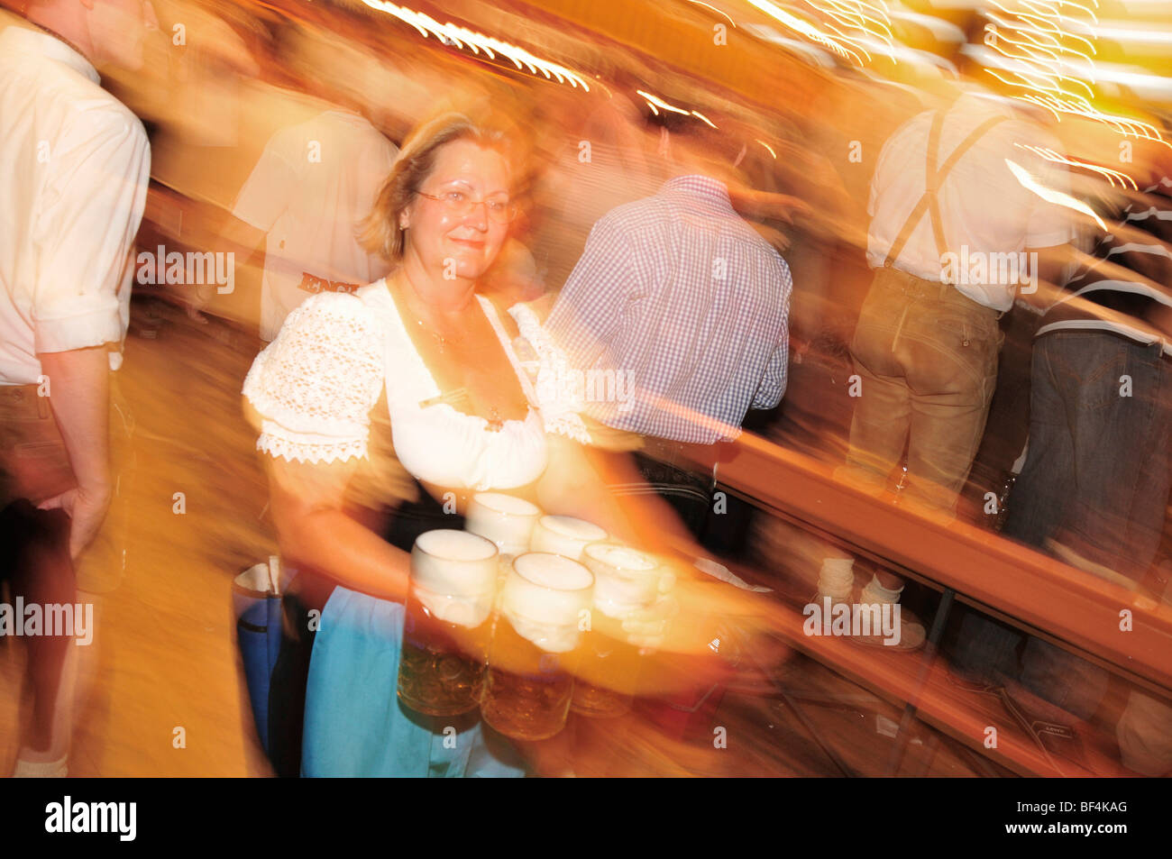 Waitress with beer mugs in the Augustiner tent, Oktoberfest, Munich, Bavaria, Germany - Stock Image