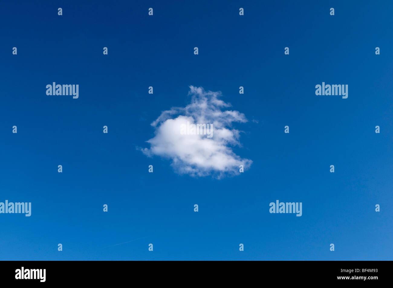 Small cumulus cloud in a blue sky - Stock Image
