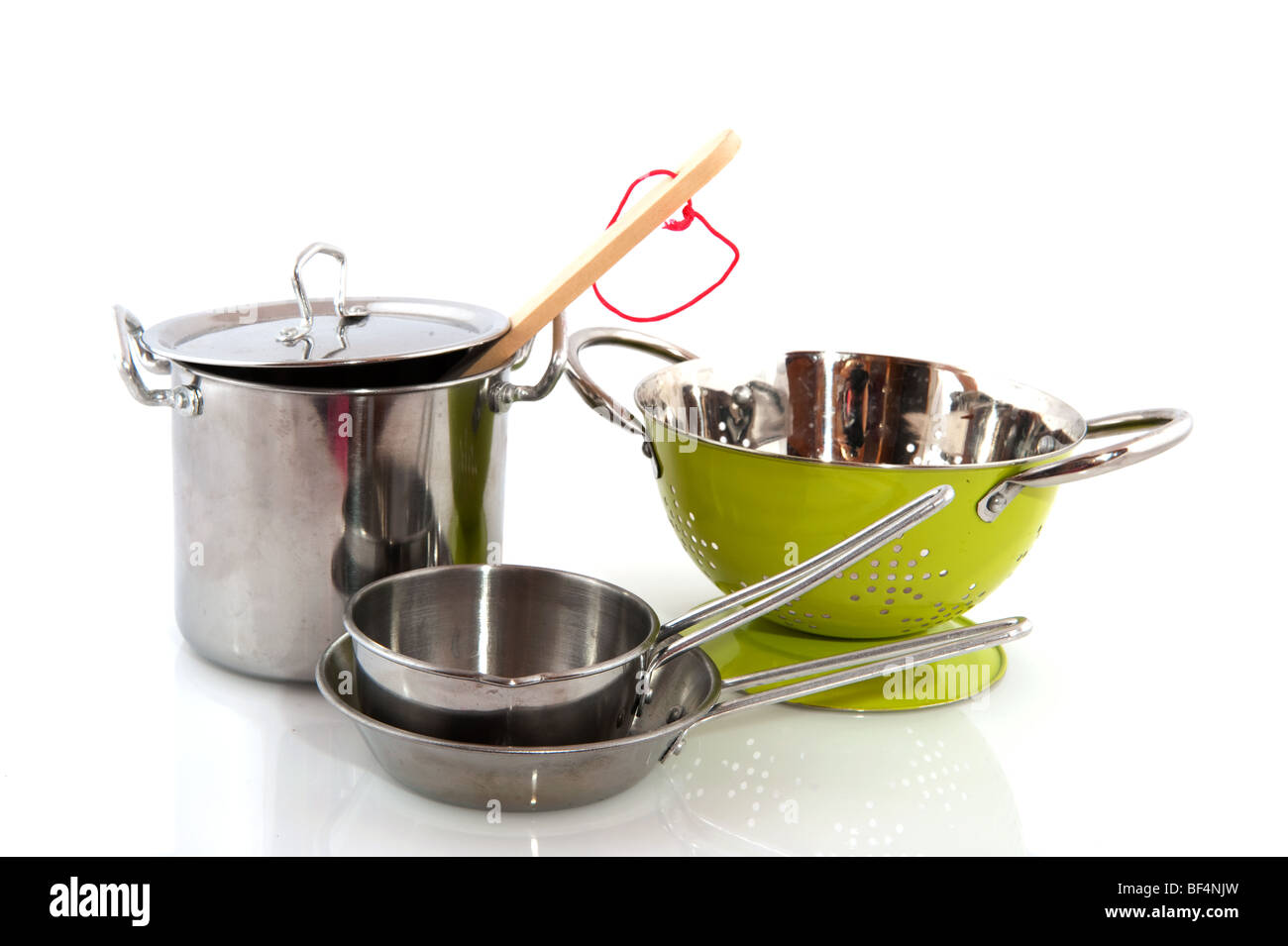 kitchen equipment with pots and pans isolated over white - Stock Image