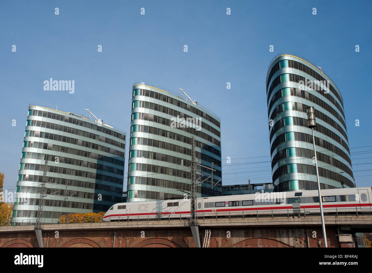 TRIAS office buildings and train in central Berlin Germany - Stock Image