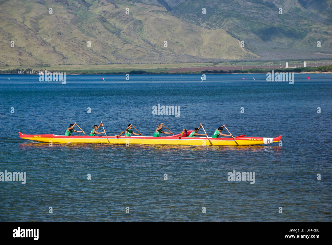 Outrigger canoe trials and competitions between local schools.  Taken from Kihei beach - Stock Image