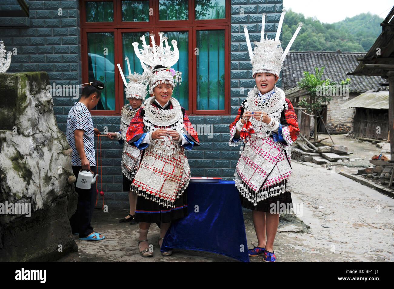 Miao women in traditional costume with silver ornaments, Zhaoxing Miao, Qiandongnan Miao and Dong, Guizhou Province, Stock Photo
