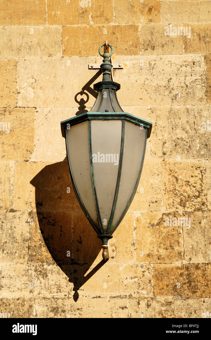 Old street lamp on a wall, High Street, Chipping Campden, Gloucestershire, England, United Kingdom, Europe - Stock Image