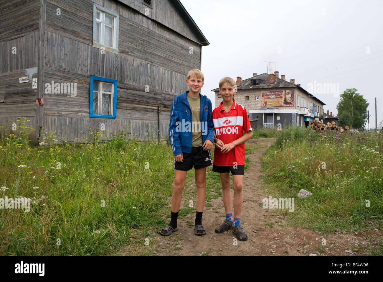 Two boys on wasteland near houses, portrait, Urals, Russia - Stock Image