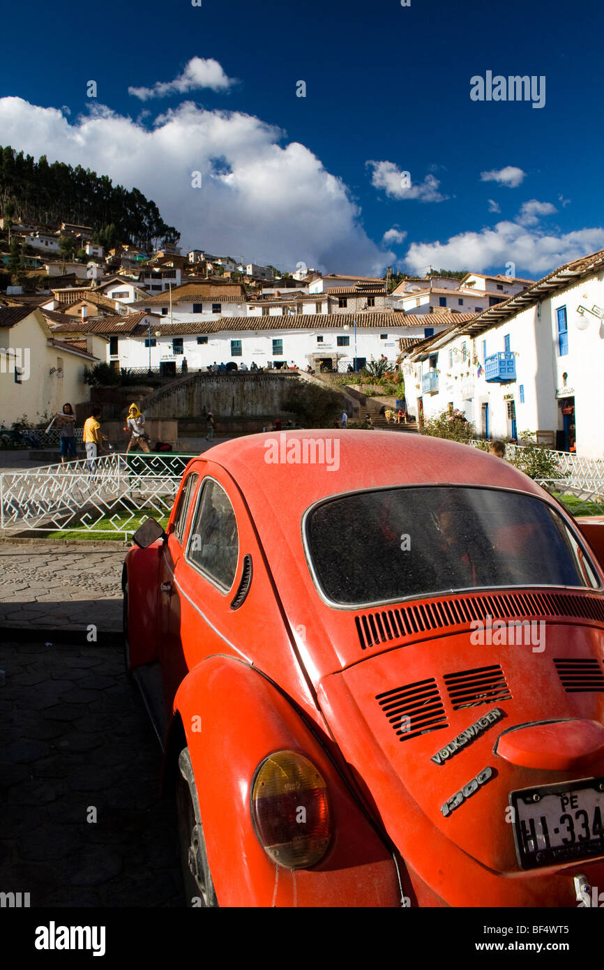 An old VW sits in the beautiful city of Cuzco, Peru in South America. Surrounded by the Spanish whitewashed architecture. - Stock Image