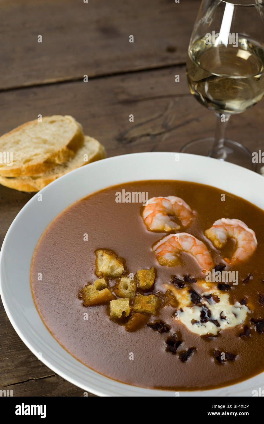 Fish soup, Soupe de Poisson, with shrimp, croutons and Dulse (Palmaria palmata), a red alga Stock Photo