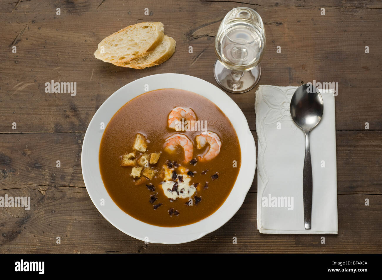 Fish soup, Soupe de Poisson, with shrimp, croutons and Dulse (Palmaria palmata), a red alga - Stock Image