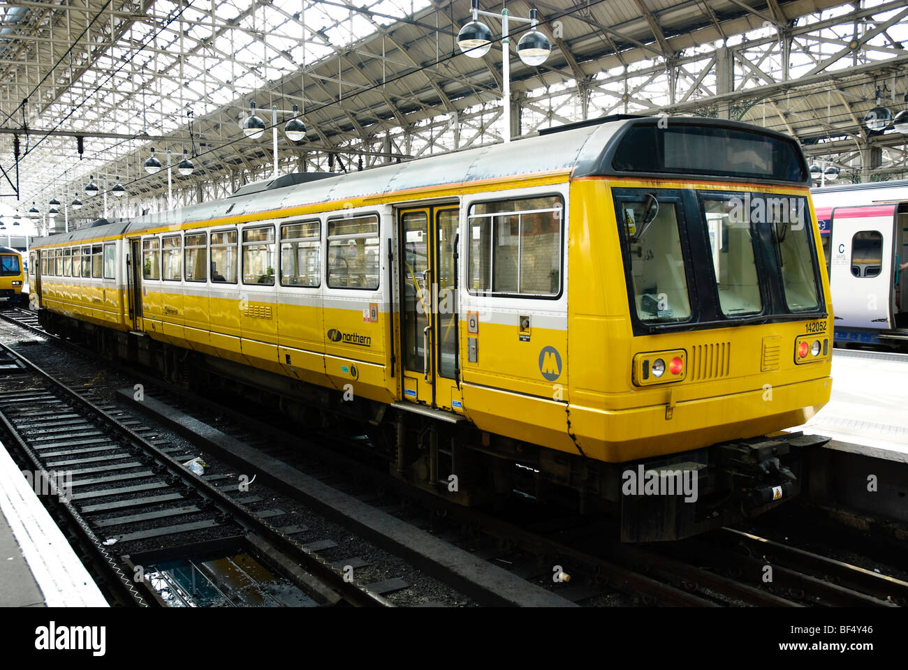 Small suburban commuter train, waiting at a station. Please click for full details. - Stock Image