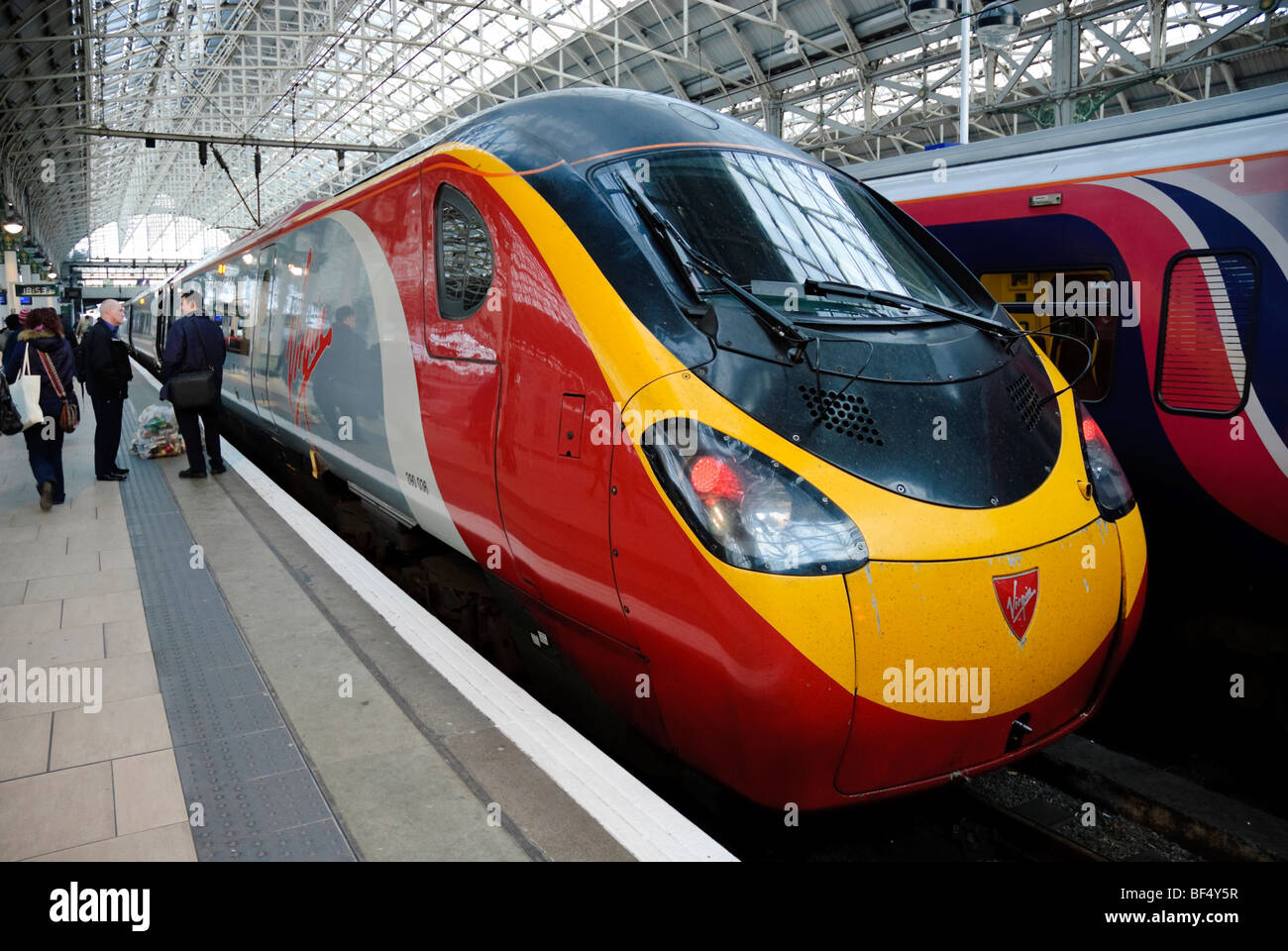 Intercity express tilt train operated by Virgin Trains: a Pendolino train at a station. Please click for details. - Stock Image