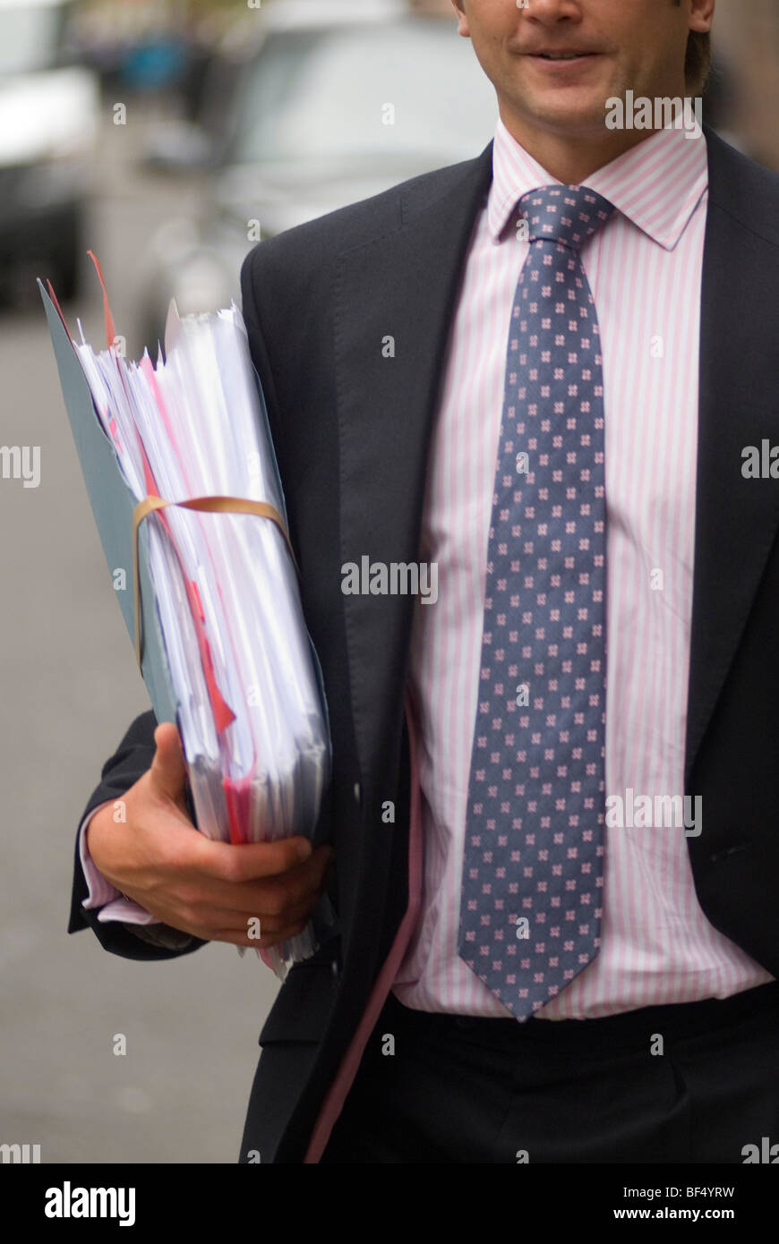 Paperwork files London city office worker. UK HOMER SYKES - Stock Image