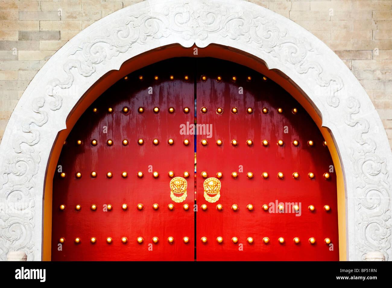 Red door panel with gold gilded door nails of Imperial Vault of Heaven in The Temple of Heaven Beijing China & Red door panel with gold gilded door nails of Imperial Vault of ...