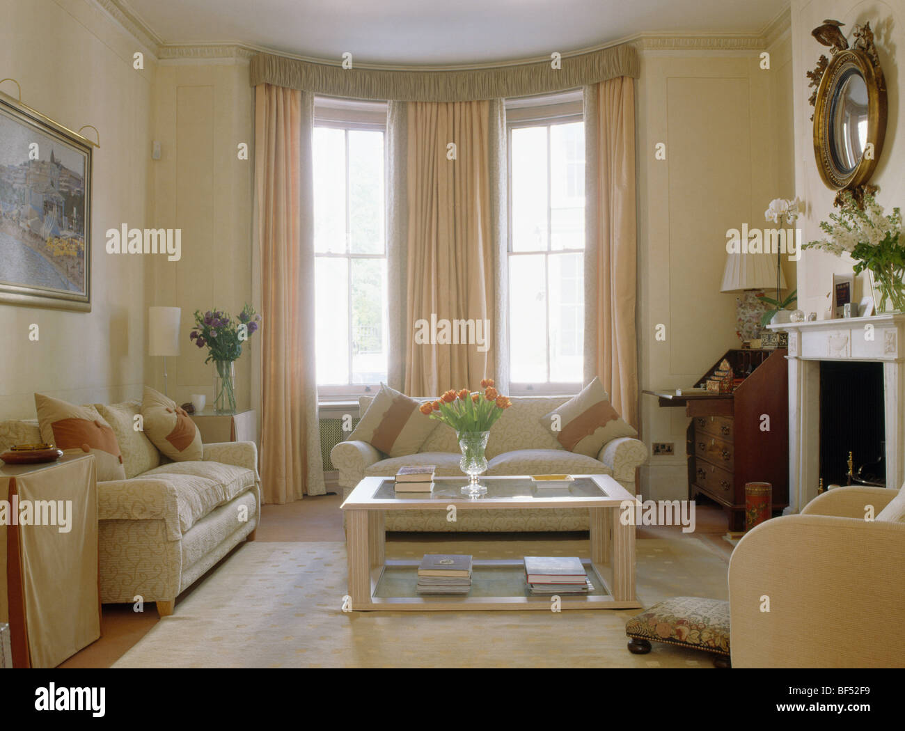 cream sofas and glass wood coffee table in traditional cream stock photo 26541965 alamy. Black Bedroom Furniture Sets. Home Design Ideas